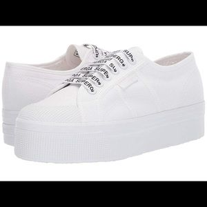 Superga white out platform sneakers